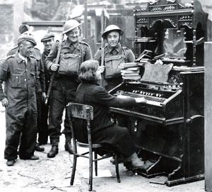 An impromptu musical interlude for servicemen. Pictures courtesy of the Belfast Telegraph