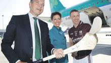AER Lingus CEO Christoph Mueller gets to grips with a hurley as cabin crew member Jane Curtin and Galway hurler Damien Joyce look on at the announcement of the carrier's partnership with the Galway Hurling Supporter's Club