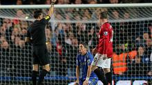 Referee Mark Clattenburg shows a red card to Chelsea's Fernando Torres. Photo: PA