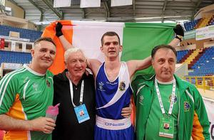 Adam Nolan celebrates with head coach Billy Walsh, left, Tommy Murphy, President of the IABA, and assistant coach Zaur Anita. Photo: Sportsfile