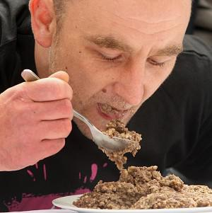 Keith Newton gets stuck into his haggis during the contest in Edinburgh
