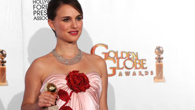Actress Natalie Portman poses with her award for Best Performance by an Actress in a Motion Picture (Drama). Photo: Getty Images