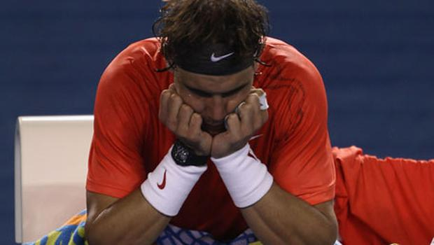 Spain's Rafael Nadal shows his disappointment after injury forced him to pull out of his Australian Open quarter-final match against David Ferrer of Spain in Melbourne yesterday. Photo: Getty Images