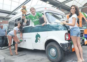 Daniel has his van attended to by models Lynn Kelly and Nadia Forde