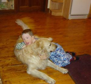 Patrick Felming (11) with his dog 'Taylor', who were reunited after the family dogs fell out of a trailer while on their way from Kerry to Dublin.
