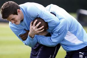 Tottenham Hotspur's Gareth Bale and Jermain Defoe share a light-hearted moment during training yesterday ahead of tonight's Champions League. Photo: PA clash with Real Madrid