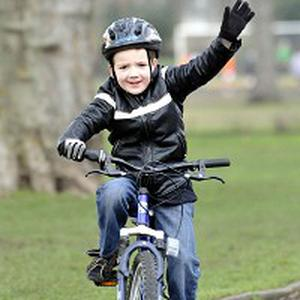 Charlie Simpson, 7, during his five mile cycle ride around South Park, west London