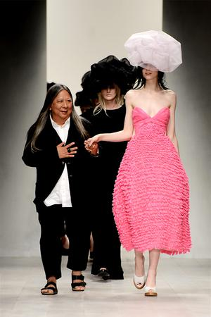 Designer John Rocha walks with his models on the catwalk during his show at London Fashion Week