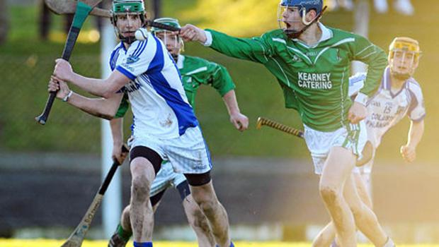 Colm Barry of St Colman's (right) tries to hook St Flannan's Cathal Doohan in yesterday's Dr Harty Cup clash. Photo: Diarmuid Greene / Sportsfile
