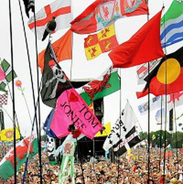 Glastonbury festival organisers are consulting fans about flags at the main stage