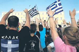 A huge crowd of protesters stands in front of the Greek parliament during a rally against austerity economic measures and corruption in Athens' Constitution (Syntagma) Square for the twelfth day running