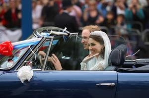 Prince William and new wife Catherine drive from Buckingham Palace in a decorated sports car. Photo: Getty Images