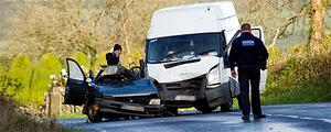 Investigators yesterday at the scene of Tuesday's crash on the Skibbereen Road outside Rosscarbery, Co Cork