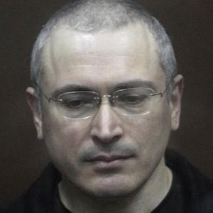 Mikhail Khodorkovsky stands behind bars in a courtroom in Moscow (AP)