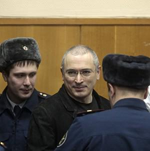 Mikhail Khodorkovsky is escorted to a courtroom in Moscow (AP)
