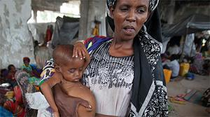 An internally displaced woman holds her malnourished son at a new settlement in Somalia's capital Mogadishu. Photo: Reuters
