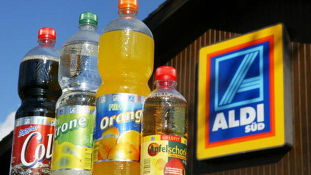 Bottles of Aldi, own-brand soft drinks are on display outside an Aldi discount grocery store in Germany. Photo: Sean Gallup/Getty Images