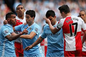 Not wanted: Joey Barton (right) is set to leave QPR after his red card for an elbow on Manchester City's Carlos Tévez (left) Photo: Getty Images