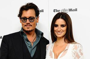 Johnny Depp and Penelope Cruz arrive for the UK premiere of Pirates of the Caribbean: On Stranger Tides. Photo: PA