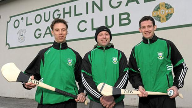 O'Loughlin Gaels players Brian Hogan (L) and Martin Comerford (R) with coach Andy Comerford ahead of their semi-final.