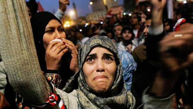 An Egyptian woman cries in Tahir Square, Cairo, after it was announced yesterday that Hosni Mubarak was giving up power. Photo: CHRIS HONDROS/GETTY