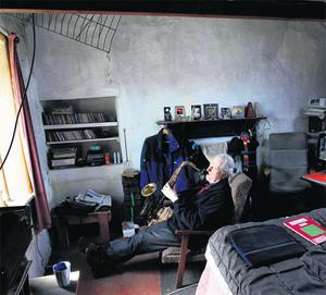 Barry Pilcher at his Inishfree home, where he spends most of his time playing his saxophone and writing poetry.