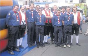 Members of the St. Patrick's Scout Group with some of the locals in Rieneck in Germany during a local festival.