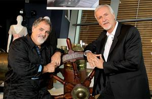 Titanic director James Cameron and producer Jon Landau stands with the donated ship's wheel from the movie during a visit to the Titanic Belfast Museum . Photo: PA