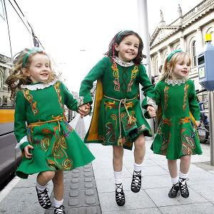 Erin Kirby, seven, Eve Kirby and Saoirse Kenny, both six, at the Luas stop on St Stephens Green Dublin