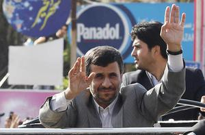 Iranian President Mahmoud Ahmadinejad waves to the crowd in a southern suberb of Beirut upon his arrival in Lebanon. Photo: Getty Images