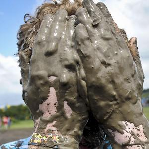 Mud is not so much of a problem for some revellers at this year's Glastonbury Festival