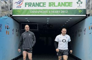 Ireland captain Paul O' Connell , left, and Tom Court walk down the players' tunnel during the captain' s run ahead of their RBS Six Nations Championship refixture against France