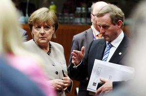 Taoiseach Enda Kenny talks with German Chancellor Angela Merkel at the two-day European Union leaders summit. Photo: Reuters