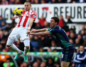 STOKE ON TRENT, ENGLAND - OCTOBER 27:  Michael Kightly of Stoke wins the ball from Craig Gardner of Sunderland during the Barclays Premier League match between Stoke City and Sunderland at Britannia Stadium on October 27, 2012 in Stoke on Trent, England.  (Photo by Matthew Lewis/Getty Images)