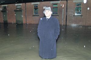 Bertie Ahern surveys the damage to homes after the River Tolka burst its bank in Dublin in November 2002