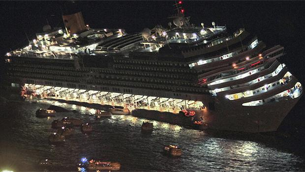 Lifeboats flee the stricken Costa Concordia as it lists heavily off the Italian coast