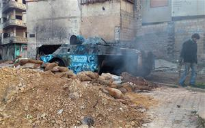 A man inspects an armoured military vehicle damaged during clashes near Khaldiyeh area in Homs. Photo: Reuters