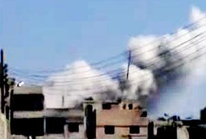 Amateur footage showing shelling in Homs. Photo: Getty Images