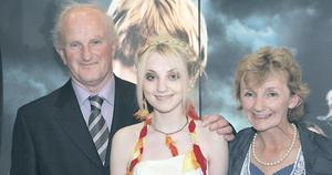 Evanna Lynch, who plays Luna Lovegood in 'Harry Potter & The Order of the Phoenix', with parents Daniel and Margaret yesterday at the movie's Irish premiere at the Savoy Cinema, Dublin