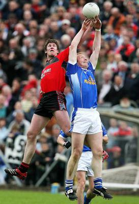 Cavan's Dermot McCabe contests a high ball with Jack Lynch of Down. McCabe made the All-Star team and won an Ulster title in 1997. OLIVER McVEIGH / SPORTSFILE