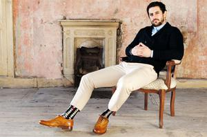 Oxford shirt, €270, doublebreasted cardigan, €610, both Gucci; stone crop pants, €255, and socks, €20, both Paul Smith, and tan brogues, €200, Grenson, all from Brown Thomas
