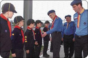 Cub Scouts from Dundalk Keith Agnew, Ian Matthews, Conor Bolton and David Lally meet Chief Scout Peter Dixon watched by Area Commissioner Pat Hanratty and Brendan McGuinness at the Scouting Ireland CSI National Conference held in the Hospitality Training Centre, Dundalk Institute of Technology.