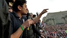 Google executive Wael Ghonim addresses a mass crowd inside Tahrir Square in Cairo yesterday after he was freed by state security who had kept him blindfolded for two weeks