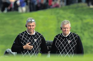 Europe's Captain Colin Montgomerie on patrol with Darren Clarke during yesterday's play at Celtic Manor