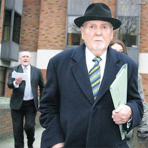 Michael Fingleton leaving the Employment Appeals Tribunal yesterday where he was pursued by former branch manager Brendan Beggan