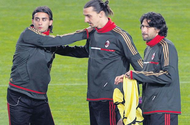 AC Milan's players Alberto Aquilani, Zlatan Ibrahimovic and Mario Yepes stretch during a training session at the Nou Camp last night