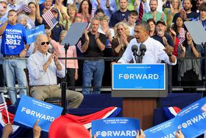 President Barack Obama speaks at a joint campaign rally with Vice President Joe Biden, left,  on Tuesday at Triangle Park in Dayton. Photo: AP