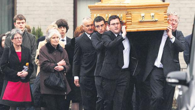 Joe Dolan and sons Gavin and Jack carry Andrew's coffin in Carrick-on-Shannon, Co Leitrim