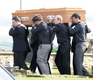 Pallbearers carry the coffin of Michael Coleman at St Augustine's Church, Dungarvan, yesterday