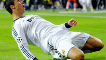 Cristiano Ronaldo slides on the Bernabeu turf after scoring his late winning goal - the 151st of his Madrid career - during last night's Champions League clash.